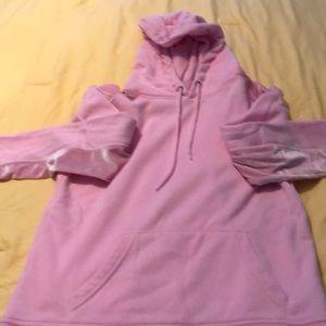A pink hooded Zine sweatshirt